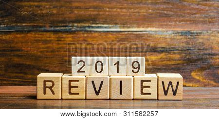Wooden Blocks With The Word Review 2019. Business Concept. Feedback, Progress. New Trends And Prospe