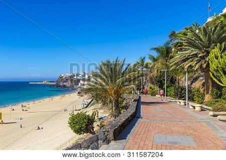 Canary Islands, Spain - December 9, 2018: People Relax On The Beach In Morro Del Jable Town (morro J