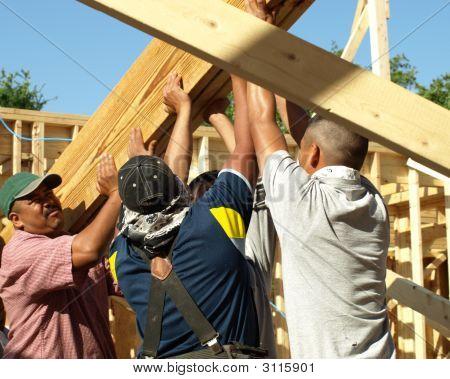 Men Putting Up The Beam