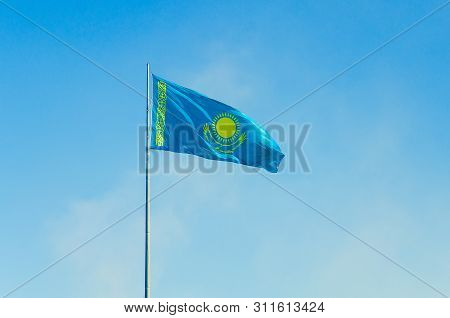 Flag Of The Republic Of Kazakhstan. Waving The Biggest Flag In Kazakhstan. Nur-sultan, Kazakhstan
