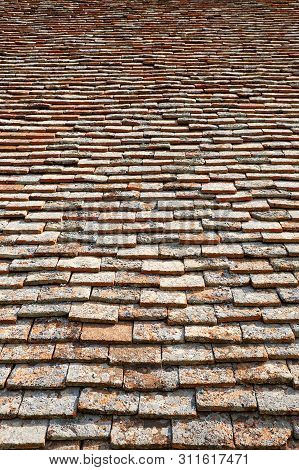 Texture Of Terracota Tiles. Old Weathered Tile Roof Background.