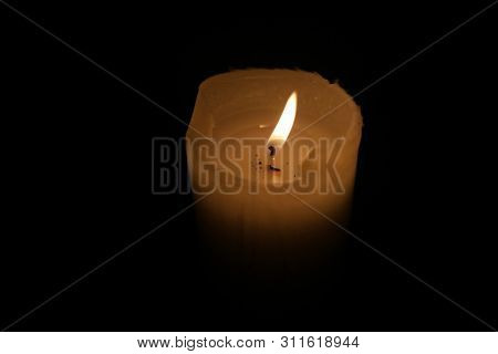 Candle burns in the dark