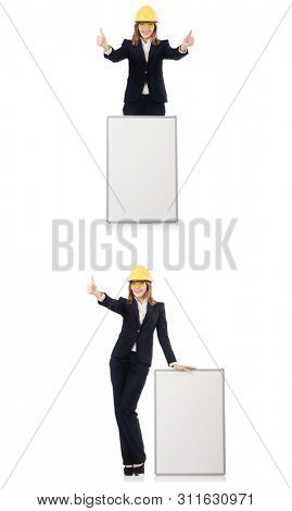 Young female builder with whiteboard