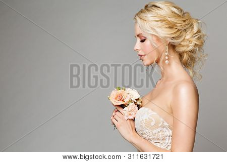 Fashion Models Profile Portrait With Flowers Bouquet, Beautiful Woman Bride Makeup And Hairstyle, Gi