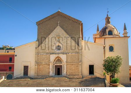 Parish S. Maria Assunta Church Building In Orbetello Town In Italy. Cathedral Of Saint Mary Assunta