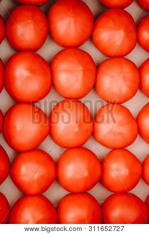 Fresh Tomatoes Are Arranged And Fill In Roll And Column Between Grid System In Open Package On Stall