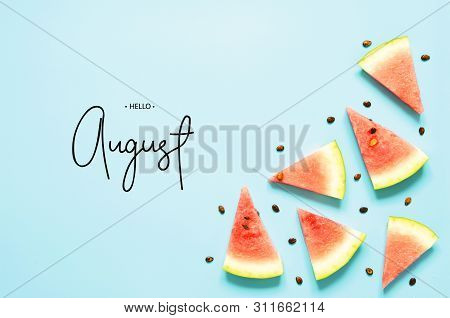 Inscription Hello August. Fresh Red Watermelon Slice Isolated Light Blue Background. Top View, Flat
