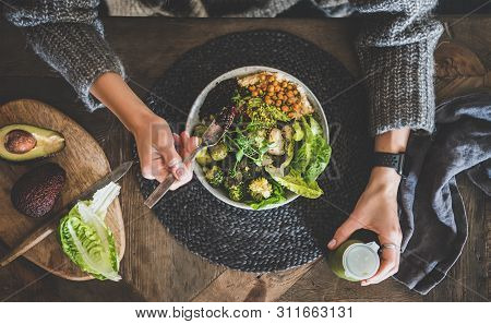 Flat-lay Of Healthy Superbowl, Smoothie And Womans Hands Over Table