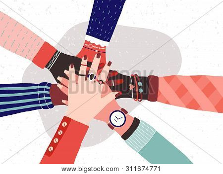 Hands Of Diverse Group Of Women Putting Together. Concept Of Sisterhood, Girl Power, Feminist Commun