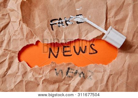 Fake News, Disinformation Or False Information And Propaganda Concept. Crumpled Paper, Inscription A