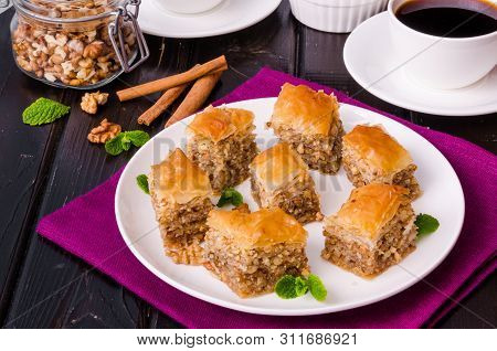 Homemade Baklava With Filo Dough And Walnuts In Honey And Sugar Syrup. Turkish Cuisine.