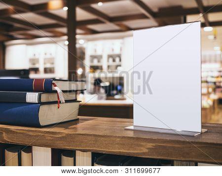 Mock Up Menu Sign Stand On Bookshelf Blur Cafe Interior Background