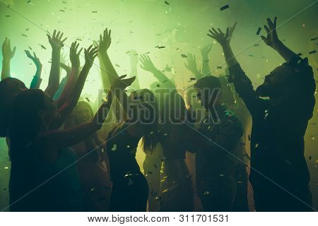 Close Up Photo Of Many Party People Dancing Clubbing Green Lights Confetti Flying Everywhere Nightcl