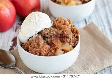 Fresh Hot Homemade Apple Crisp Or Crumble With Crunchy Streusel Topping Topped With Vanilla Bean Ice