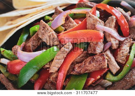 Extreme Close Up Of Beef Steak Fajita Mix . Selective Focus With Blurred Background.