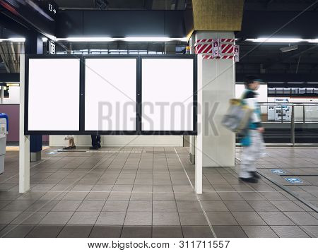 Mock Up Blank Boards Poster In Train Station Platform With People Walking