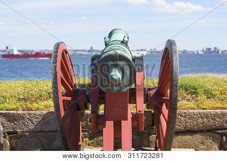 Helsingor, Denmark - July 23, 2019: Old Cannon In Front Of Kronborg Castle On The Oresund Strait, Ba