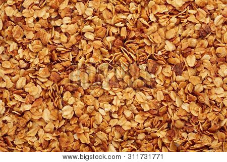 Organic Homemade Granola Cereal With Oats And Almond. Texture Oatmeal Granola Or Muesli As Backgroun