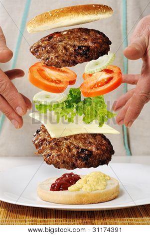Levitating zero gravity burger in hands