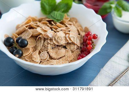 Healthy Tasty Breakfast Multigrain Wholewheat Healthy Cereals With Strawberries, Raspberries, Black