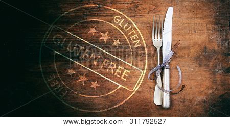 Gluten-free Certification. Stamp And Cutlery On Rustic Wooden Table, Top View.