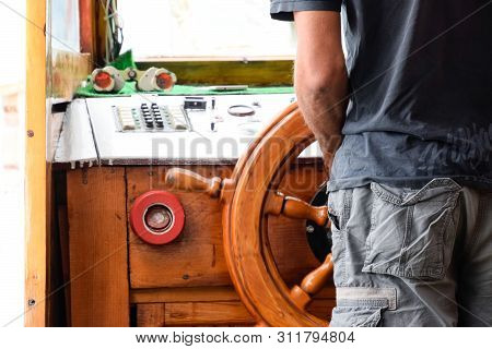 The Captain Of The Ship At The Helm. The Management Of The Yacht