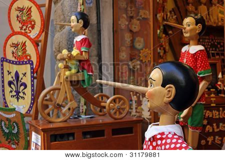 Pinocchio Inviting Tourists In Souvenirs Shop