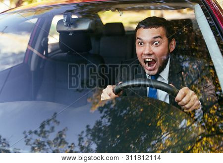 Shocked Driver In The Car, Frightened Man Driving.
