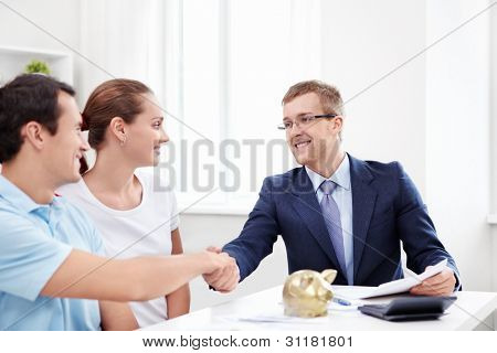 The consultant shakes hands with a man