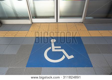 Disable Wheelchair Sign In Public Transportation At The Floor To Enter The Train In Japan, Important