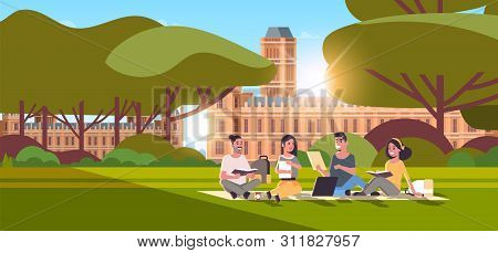 Young Teenage Students Group Sitting On Grass At Campus Yard Education Concept College Friends Relax