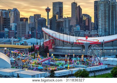 Calgary, Canada - July 14, 2019: Sunset Over Calgary Skyline With The Annual Stampede Event At The S