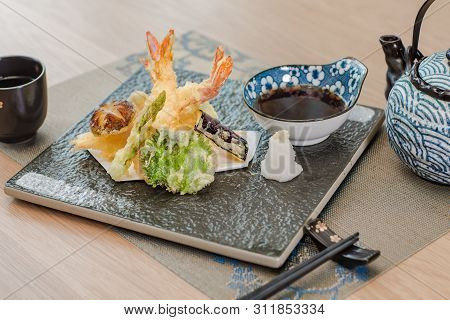 Shrimp Tempura Vegetable Platter In A Ceramic Dish