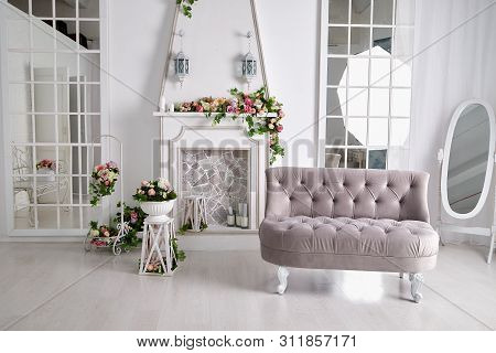 Interior Of A Living Room With A Sofa With Flowers. Location For The Photo Shoot In Pastel Colours
