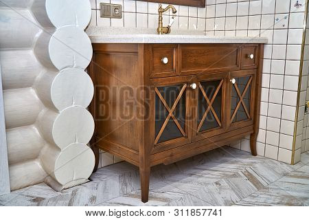 Bathroom Vanity Cabinet With Acrylic Countertop In Luxury Bathroom. Country Style. Details Furniture