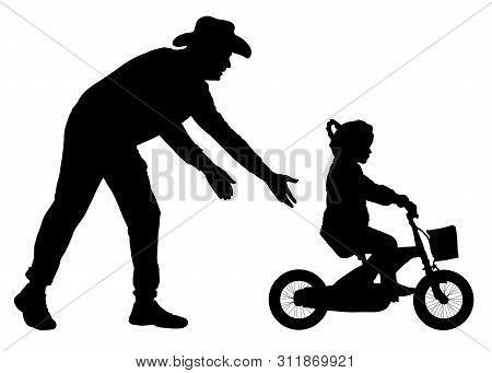 Father Teaches Daughter To Ride Bicycle Silhouette. Teaching A Child To Ride Bike Without Stabiliser