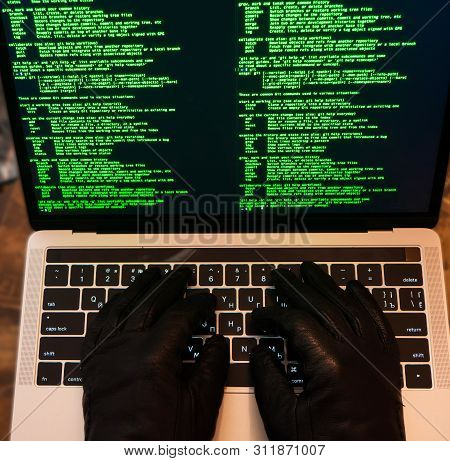 Cybercrime, Hacking And Technology Concept. Hacker Using Malicious Code Or Virus Program For Cyber A