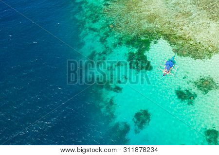 Boat On A Coral Reef. Sea Surface With An Atoll, Coral Reefs. Sea Shoal And Depth. Seascape With Tou