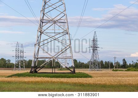 Group silhouette of transmission towers power tower, electricity pylon, steel lattice tower . Texture high voltage pillar, overhead power line. poster