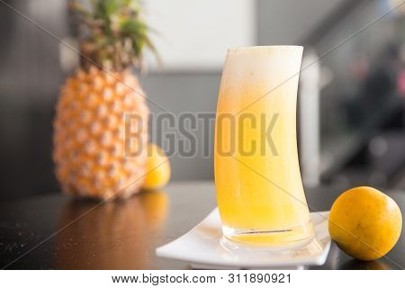 Freshly Pressed Mango Juice In A Clean Tall Glass
