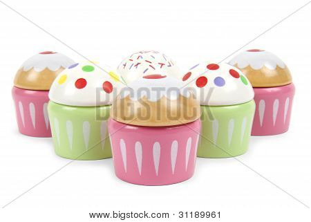 Six beautiful toy cupcakes on white background