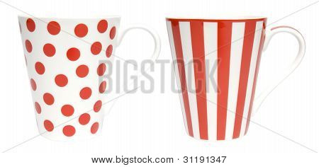 Two coffee cups one wth red dots and one with red stripes on white background. Clipping paths includ