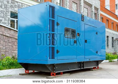 Diesel Generator For Emergency Power Supply At The Wall Of The Medical Center In Good Weather
