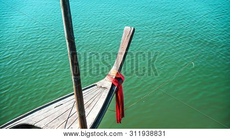 Photos Of The Bow Ship Head With Red Cloth Tied. View From Head Of Traditional Wooden Boat With Red