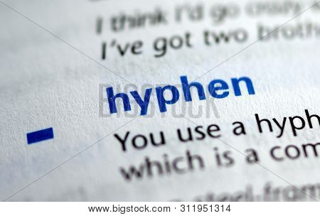Montreal, Canada - July 17, 2019: Word And Symbol Hyphen In A Dictionay With Meaning. Close-up And S