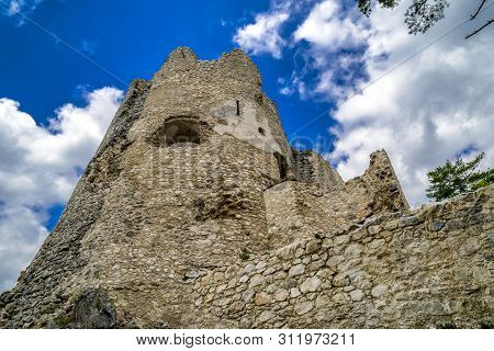 Tower Of Blatnica Castle, Slovakia. Sky With Clouds