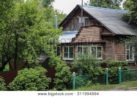 Rustic Wooden House In Trees, Beauty And Simplicity, Relaxation From Vain Worries