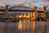 Vancouver - Burrard Bridge at sunset viewed from Granville Island poster