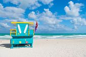 Miami beach colorful lifeguard towers. Quirky iconic structures. Lifeguard towers South Beach unique worth taking leisurely stroll to see. Explore South beach. Turquoise and yellow surfboard designs. poster