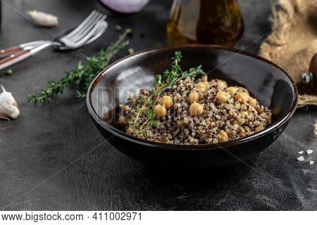 Close-up View Of Bowl Of Quinoa Salad With Chickpea. Buddha Bowl With Quinoa, Chickpeas And Thyme. S